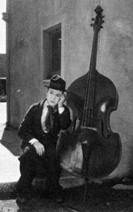 "Harry Langdon and a double bass in a still from ""Fiddlesticks""."